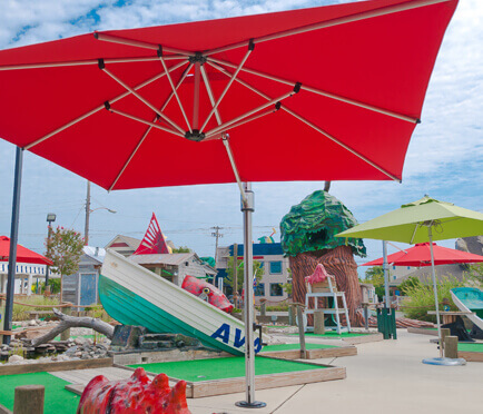 Frankford Recreation Umbrellas providing shade for a recreational mini golf course