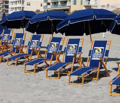 Frankford Avalon beach umbrellas shading a row of navy blue branded beach chairs at Myrtle Beach