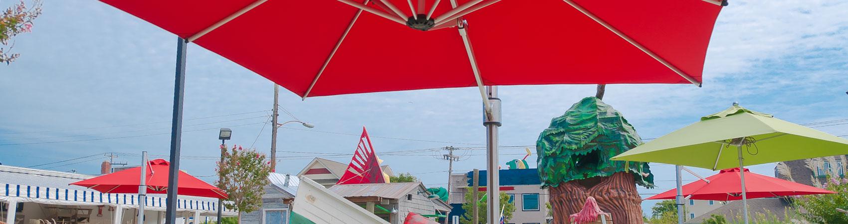 Frankford Recreation Umbrellas providing shade for a recreational mini golf course