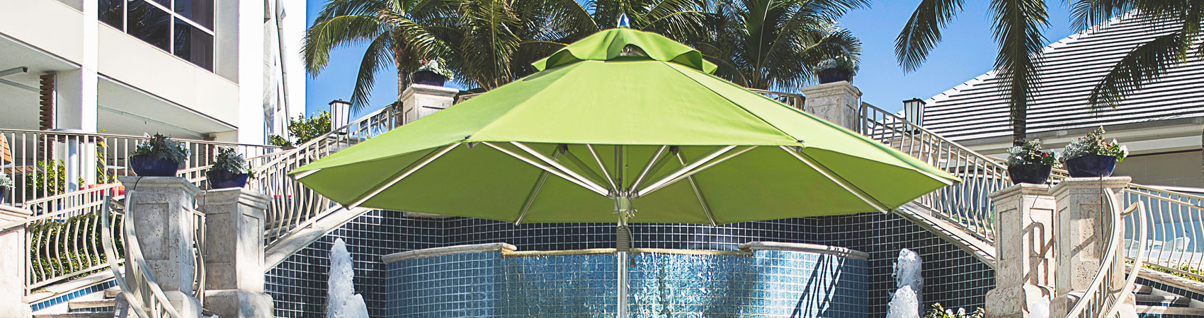 Green Frankford Greenwich Market Umbrella in a luxurious hospitality setting