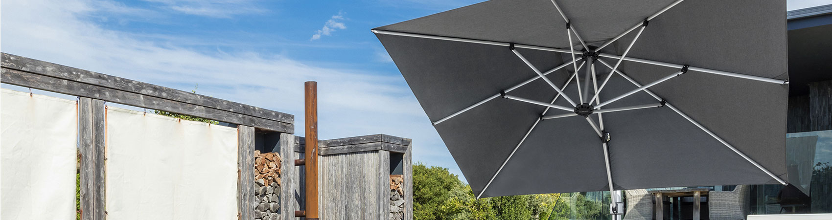 Gray Frankford Cantilever Umbrella shading the pool of a modern home